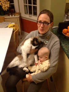 Weighing the difference: the cat is bigger than the 5-month-old baby.
