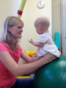 Lyra working with her physical therapist